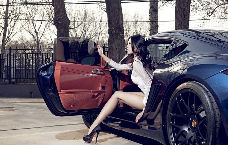 Hot Thai girl getting out of a sports car
