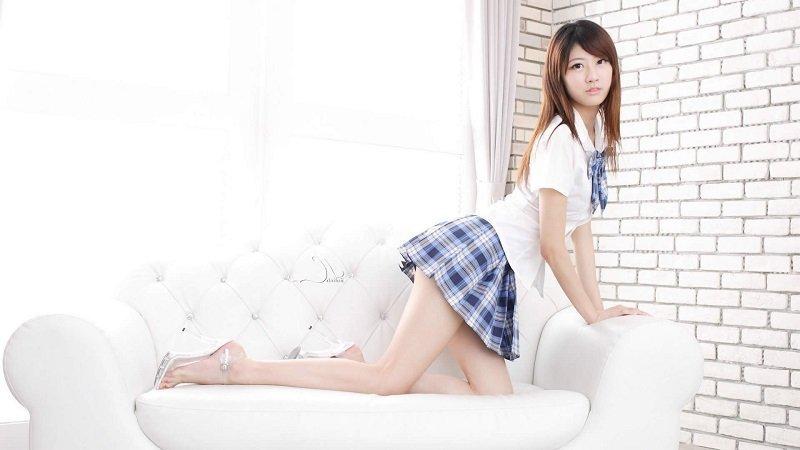 Japanese looking girl in sexy school uniform