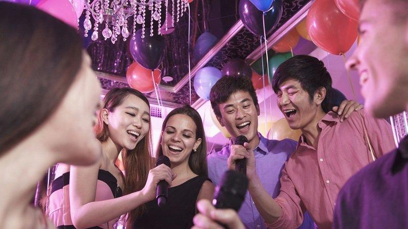 Asian singing at a Karaoke bar