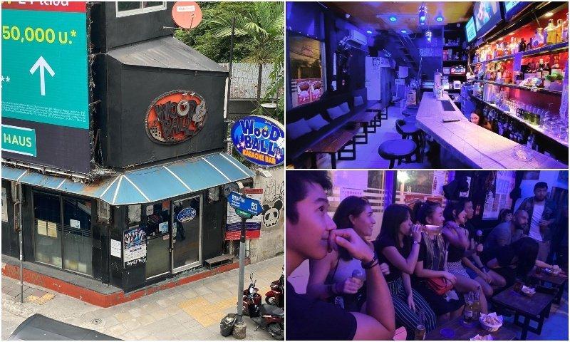 Exterior bar and people singing at Woodball Karaoke in Thonglor Bangkok
