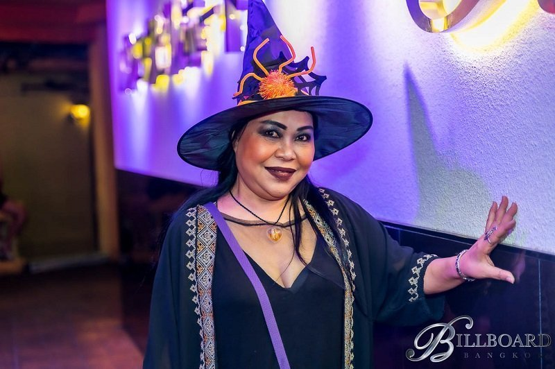 mamasan at Billboard gogo bar in Bangkok dressed for as a witch for halloween