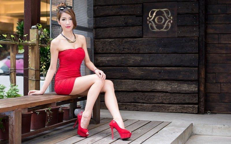 Beautiful Thai hooker in red dress