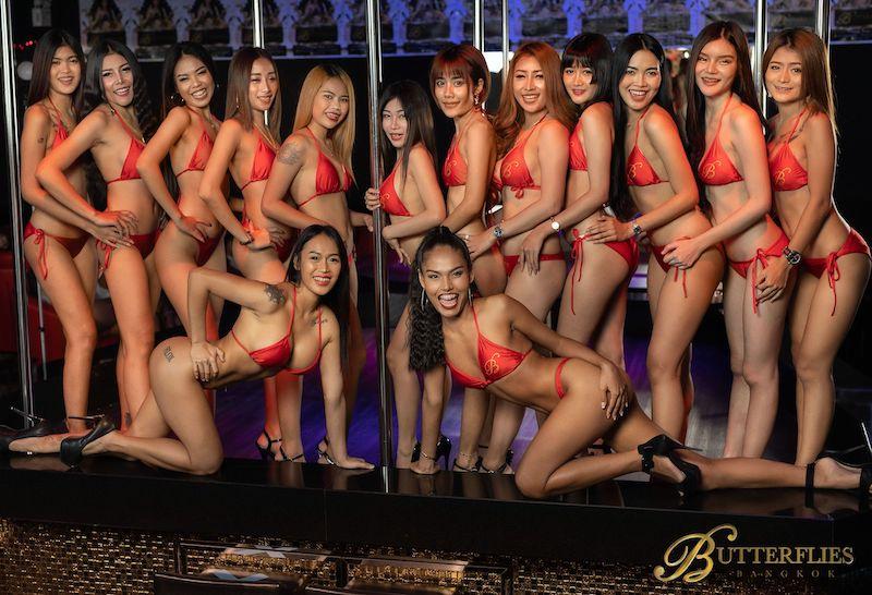 beautiful Thai gogo dancers in bikini on stage of the Butterflies Bangkok gogo bar in Nana Plaza Bangkok