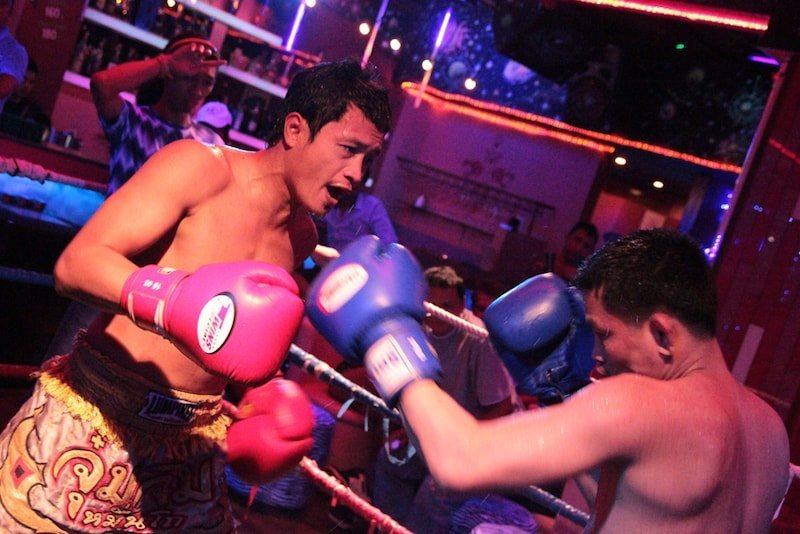 Muay Thai fighters inside pink panther gogo bar in Patpong Bangkok